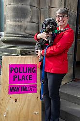 Pictured: Maggie Chapman was joined by Dougal the rescue dog for the important vote<br />