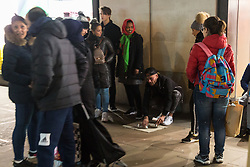 Street gambling with cups takes place on Oxford Street Outside Primark near Marble Arch. Homeless Britons are coming under increasing pressure as a surge of Roma beggars from Romania arrive on the streets of London to take advantage of the generosity of Christmas shoppers. London, December 04 2018.