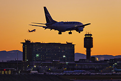 March 16, 2020, Richmond, British Columbia, Canada: A WestJet Airlines Boeing 737-600 (C-GWCQ) passenger jet lands at sunset, Vancouver International Airport, Richmond. Earlier in the day the Canadian Government, in an effort to stop the spread of the novel coronavirus, announced that the nation's borders would be closed starting Wednesday, to all travelers other than Canadian citizens and permanent residents, U.S. citizens, and diplomats and essential workers. (Credit Image: © Bayne Stanley/ZUMA Wire)