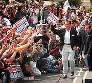 Costa Mesa, CA, USA, Oct. 10th 2003: On the first day of the Arnold Schwarzenegger campaign bus tour throughout California, the gubernatorial candidate had to face charges of alleged sexual harassment of six women as well as an old article quoting him admiring Adolf Hitler as a leader.<br /> <br />  *** Local Caption *** , posted on Corbis web ,