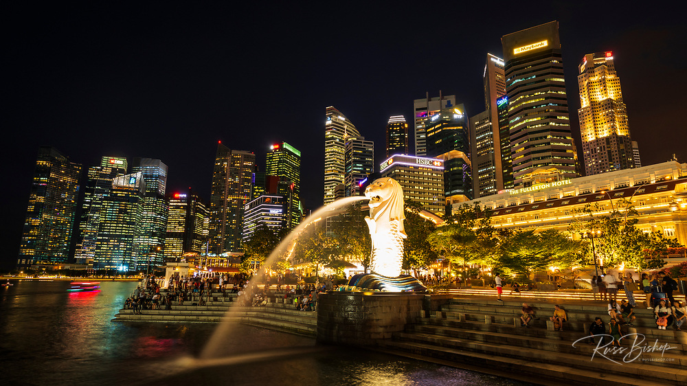 Merlion fountain and business district at night, Singapore, Republic of Singapore