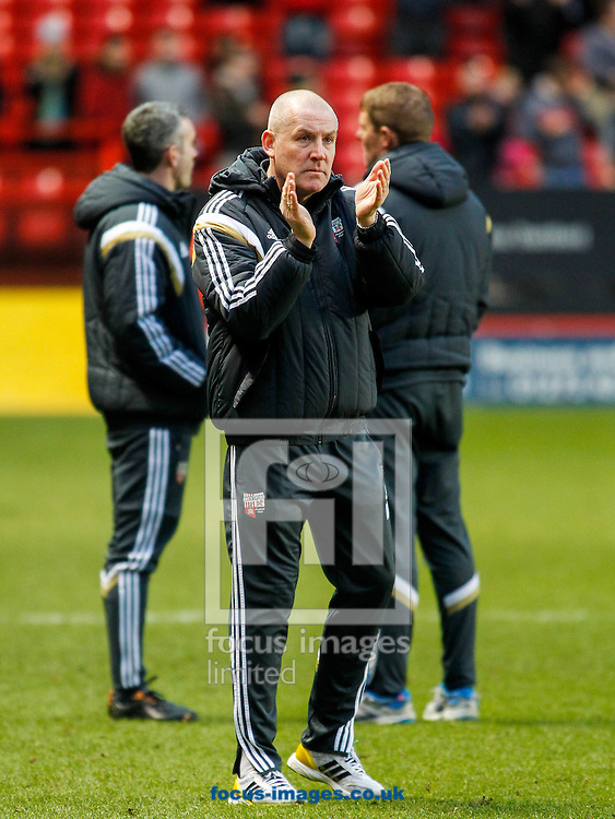 Brentford Manager Mark Warburton acknowledges the support of the Bees fans after the Sky Bet Championship match between Charlton Athletic and Brentford at The Valley, London<br /> Picture by Mark D Fuller/Focus Images Ltd +44 7774 216216<br /> 14/02/2015