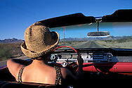 Driving on Route 66, Near Oatman, 1962 Cadillac Convertible, Arizona, USA