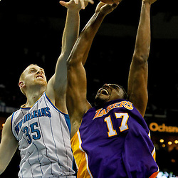 April 9, 2012; New Orleans, LA, USA; New Orleans Hornets center Chris Kaman (35) blocks a shot by Los Angeles Lakers center Andrew Bynum (17) during the fourth quarter of a game at the New Orleans Arena. The Lakers defeated the Hornets 93-91. Mandatory Credit: Derick E. Hingle-US PRESSWIRE