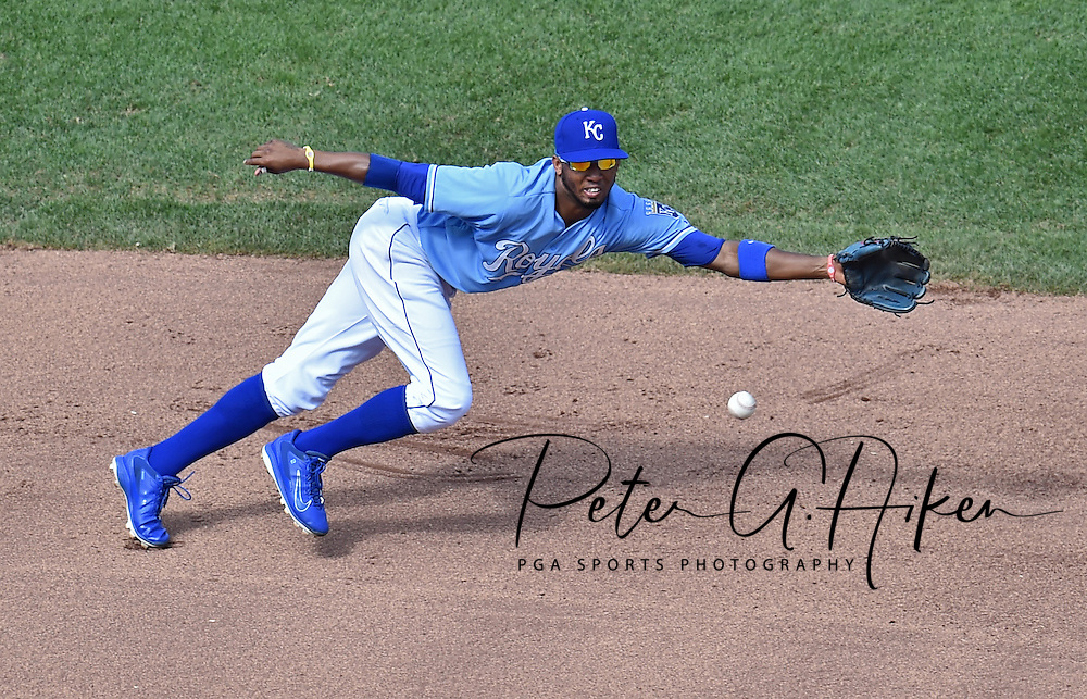 Kansas City Royals shortstop Alcides Escobar (2) dives for a base hit from Boston Red Sox Mookie Betts (not pictured) during the sixth inning at Kauffman Stadium.