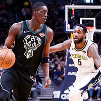 01 April 2018: Milwaukee Bucks guard Tony Snell (21) drives past Denver Nuggets forward Will Barton (5) during the Denver Nuggets 128-125 victory over the Milwaukee Bucks, at the Pepsi Center, Denver, Colorado, USA.