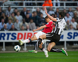 NEWCASTLE, ENGLAND - Tuesday, April 19, 2011: Manchester United's Javier Hernandez in action against Newcastle United's Jose Enrique during the Premiership match at St James' Park. (Photo by David Rawcliffe/Propaganda)