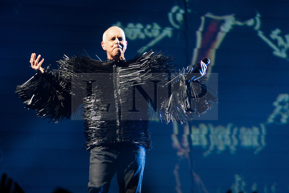 © Licensed to London News Pictures. 18/06/2013. London, UK.   Pet Shop Boys performing live at The O2 Arena - Neil Tennant in this picture. Pet Shop Boys are an English electronic pop duo, consisting of Neil Tennant, who provides main vocals, keyboards and occasional guitar, and Chris Lowe on keyboards and occasional vocals.  Photo credit : Richard Isaac/LNP