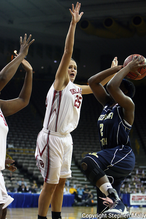 24 MARCH 2009: Oklahoma guard Whitney Hand (25) tries to block a shot by Georgia Tech guard Mo Bennett (2) during an NCAA Women's Tournament basketball game Tuesday, March 24, 2009, at Carver-Hawkeye Arena in Iowa City, Iowa. Oklahoma defeated Georgia Tech 69-50.