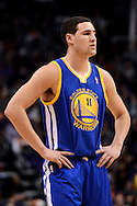 Dec 15, 2013; Phoenix, AZ, USA; Golden State Warriors guard Klay Thompson (11) reacts on the court against the Phoenix Suns in the first half at US Airways Center. The Suns defeated the Warriors 106-102. Mandatory Credit: Jennifer Stewart-USA TODAY Sports