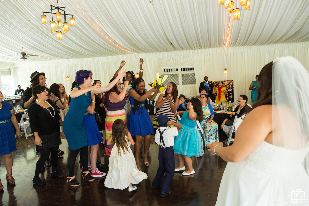 Yesi and Allegra celebrate their wedding with family and friends at Wedgewood Wedding & Banquet Center Napa at Kennedy Park in Napa, California, on May 30, 2015. (Stan Olszewski/SOSKIphoto)
