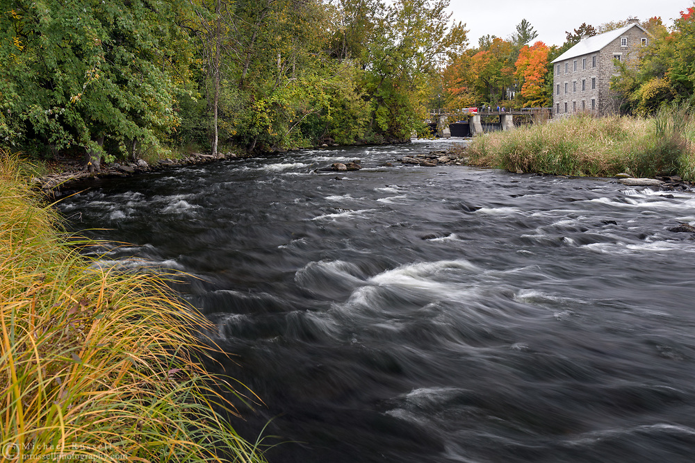 The Rideau River and Watson's Mill -  a working 1860's era grist and flour mill located in Manotick (suburb of Ottawa, Ontario). Photographed from A. Y. Jackson Park.