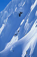 Skier on steep mountain slope