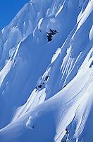 Skier on steep mountain slope