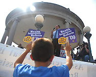 September 13, 2009- William Sneider, 8, from Boston, MA, watches Massachusetts Congressman Mike Capuano speak at the Democratic Health Care Rally at Boston Common in Boston, MA.