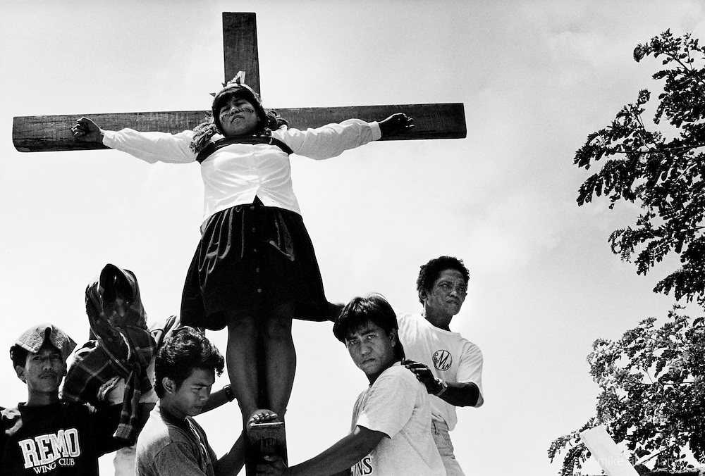 Pilgrims are crucified as part of the Easter, Holy Week celebrations. Kapitangan, Bulacan Province. The Philippines