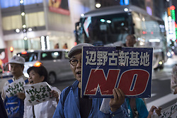 "September 28, 2016 - Tokyo, Tokyo, Japan - Protestor has a sign reads ""No Henoko base"" during the demonstration against the construction of a new U.S. military base in Okinawa. The Executive Committee Stop Henoko organized the demonstration as the Abe government continues to put pressure on Okinawa to allow the project to proceed. (Credit Image: © Alessandro Di Ciommo via ZUMA Wire)"