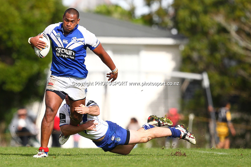 Ukuma Ta'ai looks to slip a tackle during a NSW Cup rugby league game, Auckland Vulcans v Canterbury Bankstown Bulldogs, Birkenhead War Memorial, Auckland, New Zealand. Saturday 19 May, 2012. Photo: Wayne Drought / photosport.co.nz