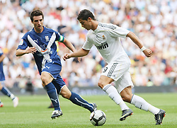 Real Madrid's Cristiano Ronaldo (r) and Tenerife's Bellvis during La Liga match.September 2 2009.