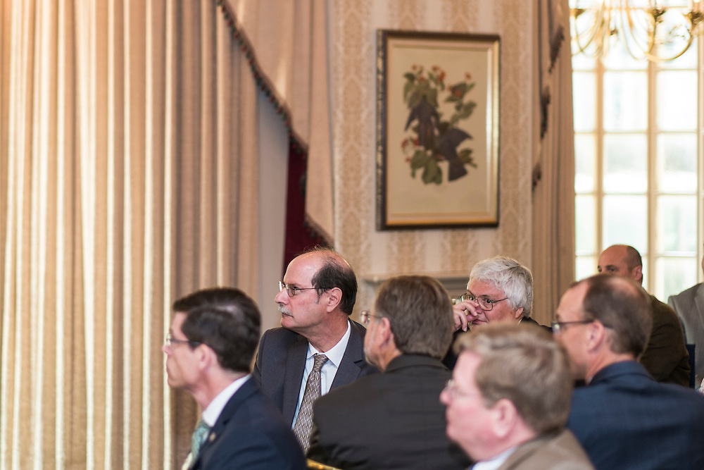 Voinovich School founding dean Mark Weinberg, second from left, listens as fromer Ohio Senator George Voinovich announces a newly endowed scholarship in Weinberg's honor.  Photo by Ohio University  /  Rob Hardin