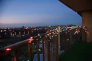 balcony with Christmas lights at sunset