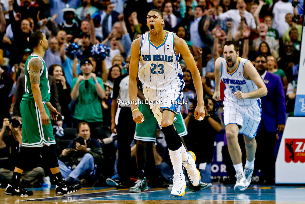 Mar 20, 2013; New Orleans, LA, USA; New Orleans Hornets power forward Anthony Davis (23) celebrates after making a game winning shot against the Boston Celtics during the fourth quarter of a game at the New Orleans Arena. The Hornets defeated the Celtics 87-86. Mandatory Credit: Derick E. Hingle-USA TODAY Sports