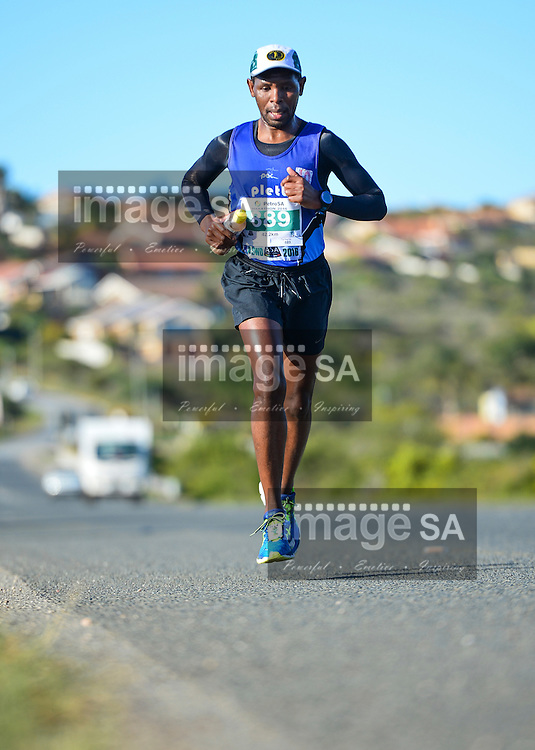 MOSSEL BAY, SOUTH AFRICA - SEPTEMBER 24: Eric Ngangu during the PetroSA Marathon finishing at Santos Caravan Park on September 24, 2016 in Mossel Bay, South Africa. (Photo by Roger Sedres/Gallo Images)