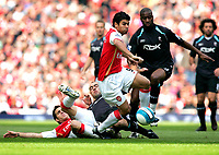 Photo: Tom Dulat.<br /> Arsenal v Bolton Wanderers. The FA Barclays Premiership. 20/10/2007.<br /> Eduardo of Arsenal manages to get the ball from Abdoulaye Meite of Bolton(R).