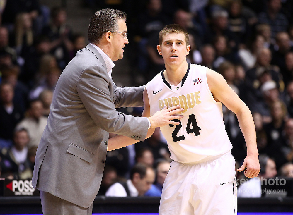 Feb. 12, 2012; West Lafayette, IN, USA; Purdue Boilermakers head coach Matt Painter talks to Purdue Boilermakers guard Ryne Smith (24) during a timeout against the Northwestern Wildcats at Mackey Arena. Purdue defeated Northwestern 87-77. Mandatory credit: Michael Hickey-US PRESSWIRE