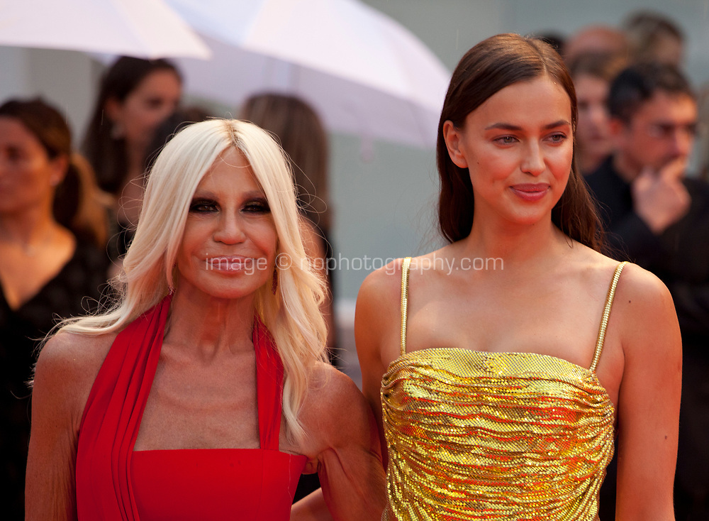 Designer Donatella Versace and model Irina Shayk at the premiere gala screening of the film A Star is Born at the 75th Venice Film Festival, Sala Grande on Friday 31st August 2018, Venice Lido, Italy.