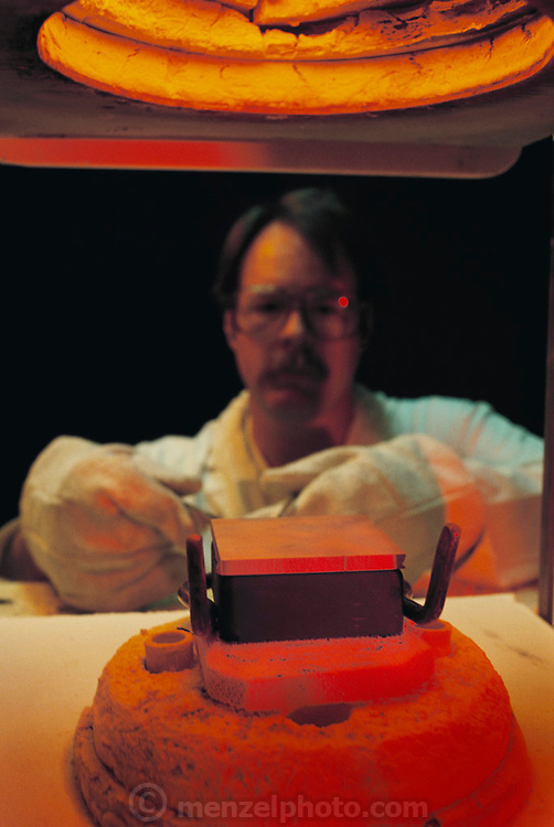 Physics: Lawrence Livermore National Lab in Livermore, California. New Materials: Cermet. Paul Curtis putting ceramic and aluminum in oven. MODEL RELEASED [1991]