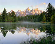 1200-1001C ~ Copyright:  George H. H. Huey ~ Sunrise on Grand Tetons with beaver pond along Snake River.  Grand Teton National Park, Wyoming