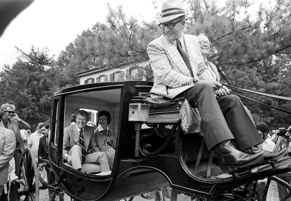 Democratic presidential candidate Jimmy Carter, his wife Rosalyn, and daughter Amy ride in a 1850's carriage in Westville, Georgia on the occasion of the United States bicentennial on July 4, 1976.