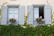 Woman at her window, Labastide d'Armagnac, France