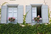 Woman at her window, Labastide d'Armagnac, France