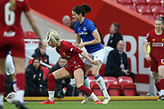 Liverpool women forward Kirsty Linnett (24) holds off Everton women midfielder Abbey-Leigh Stringer (13) during the FA Women's Super League match between Liverpool Women and Everton Women at Anfield, Liverpool, England on 17 November 2019.