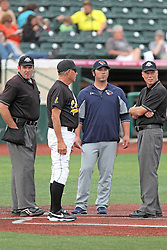 06 July 2013:   Plate umpire Mark Winters, Brooks Carey, ?, Dave Logan field umpire exchange line up cards  during a Frontier League Baseball game between the Gateway Grizzlies and the Normal CornBelters at Corn Crib Stadium on the campus of Heartland Community College in Normal Illinois