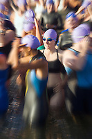 Female swimmer preparing for start of triathlon&#xA;<br />
