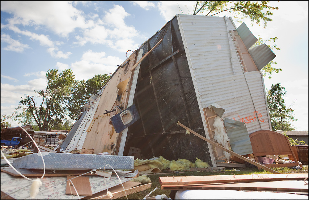 A trailer ripped apart and laying on its side by an EF-3 tornado in Sedalia, Missouri.