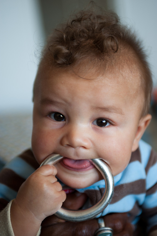 baby with silver bracelet, teething
