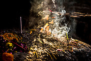 "29th January 2015, New Delhi, India. Incense left by believers smokes in the ruins of Feroz Shah Kotla in New Delhi, India on the 29th January 2015<br /> <br /> PHOTOGRAPH BY AND COPYRIGHT OF SIMON DE TREY-WHITE a photographer in delhi. + 91 98103 99809. Email:simon@simondetreywhite.com<br /> <br /> People have been coming to Firoz Shah Kotla to leave written notes and offerings for Djinns in the hopes of getting wishes granted since the late 1970's. Jinn, jann or djinn are supernatural creatures in Islamic mythology as well as pre-Islamic Arabian mythology. They are mentioned frequently in the Quran  and other Islamic texts and inhabit an unseen world called Djinnestan. In Islamic theology jinn are said to be creatures with free will, made from smokeless fire by Allah as humans were made of clay, among other things. According to the Quran, jinn have free will, and Iblīs abused this freedom in front of Allah by refusing to bow to Adam when Allah ordered angels and jinn to do so. For disobeying Allah, Iblīs was expelled from Paradise and called ""Shayṭān"" (Satan).They are usually invisible to humans, but humans do appear clearly to jinn, as they can possess them. Like humans, jinn will also be judged on the Day of Judgment and will be sent to Paradise or Hell according to their deeds. Feroz Shah Tughlaq (r. 1351–88), the Sultan of Delhi, established the fortified city of Ferozabad in 1354, as the new capital of the Delhi Sultanate, and included in it the site of the present Feroz Shah Kotla. Kotla literally means fortress or citadel."