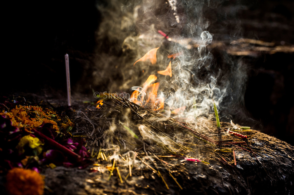 29th January 2015, New Delhi, India. Incense left by believers smokes in the ruins of Feroz Shah Kotla in New Delhi, India on the 29th January 2015<br /> <br /> PHOTOGRAPH BY AND COPYRIGHT OF SIMON DE TREY-WHITE a photographer in delhi. + 91 98103 99809. Email:simon@simondetreywhite.com<br /> <br /> People have been coming to Firoz Shah Kotla to leave written notes and offerings for Djinns in the hopes of getting wishes granted since the late 1970's. Jinn, jann or djinn are supernatural creatures in Islamic mythology as well as pre-Islamic Arabian mythology. They are mentioned frequently in the Quran  and other Islamic texts and inhabit an unseen world called Djinnestan. In Islamic theology jinn are said to be creatures with free will, made from smokeless fire by Allah as humans were made of clay, among other things. According to the Quran, jinn have free will, and Iblīs abused this freedom in front of Allah by refusing to bow to Adam when Allah ordered angels and jinn to do so. For disobeying Allah, Iblīs was expelled from Paradise and called &quot;Shayṭān&quot; (Satan).They are usually invisible to humans, but humans do appear clearly to jinn, as they can possess them. Like humans, jinn will also be judged on the Day of Judgment and will be sent to Paradise or Hell according to their deeds. Feroz Shah Tughlaq (r. 1351&ndash;88), the Sultan of Delhi, established the fortified city of Ferozabad in 1354, as the new capital of the Delhi Sultanate, and included in it the site of the present Feroz Shah Kotla. Kotla literally means fortress or citadel.