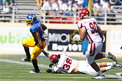 September 24, 2011; San Jose, CA, USA; San Jose State Spartans running back Brandon Rutley (9) breaks a tackle from New Mexico State Aggies linebacker B.J. Adolpho (36) during the first quarter at Spartan Stadium.
