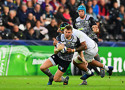 Ospreys' Dan Biggar is tackled by Clermont Auvergne's Sebastien Vahaamahina - Mandatory by-line: Craig Thomas/JMP - 15/10/2017 - RUGBY - Liberty Stadium - Swansea, Wales - Ospreys Rugby v Clermont Auvergne - European Rugby Champions Cup