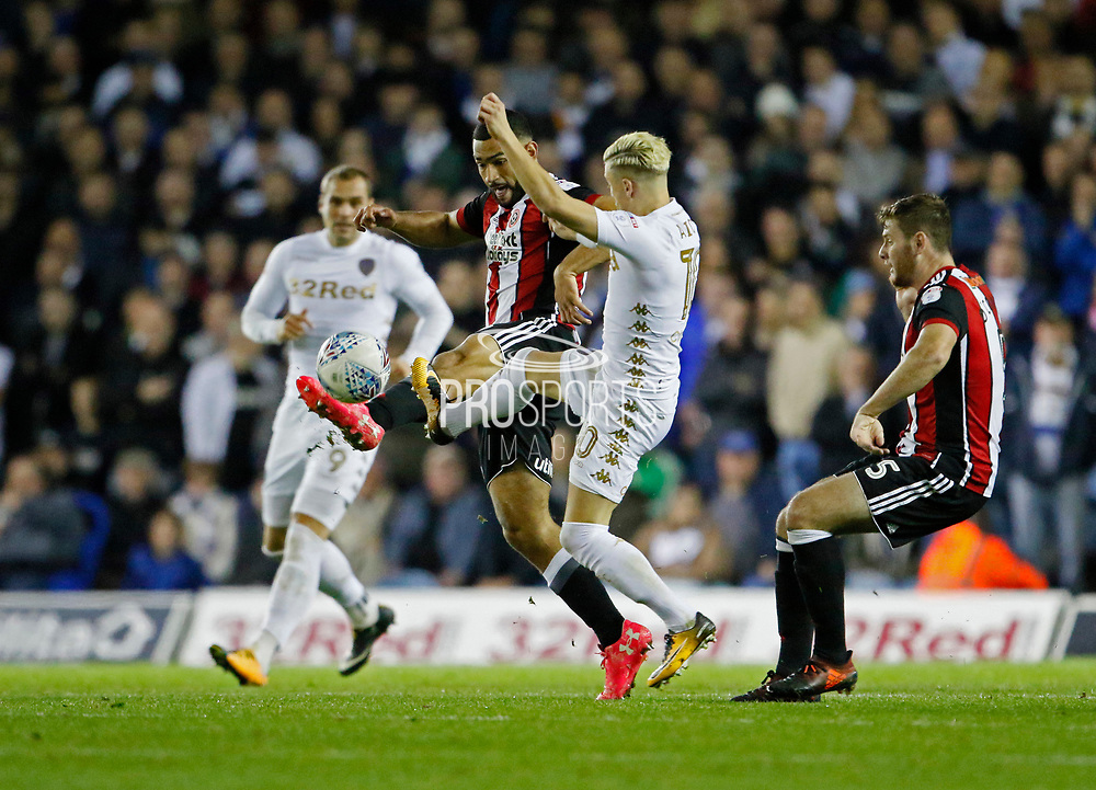 Sheffield United's Chris Basham clears from Ezgjan Alioski of Leeds United  during the EFL Sky Bet Championship match between Leeds United and Sheffield Utd at Elland Road, Leeds, England on 27 October 2017. Photo by Paul Thompson.