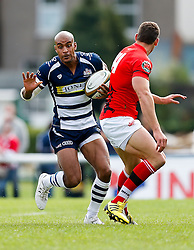Bristol Rugby Winger Tom Varndell is challenged by London Welsh Winger Chris Elder - Mandatory byline: Rogan Thomson/JMP - 07966 386802 - 13/09/2015 - RUGBY UNION - Old Deer Park - Richmond, London, England - London Welsh v Bristol Rugby - Greene King IPA Championship.
