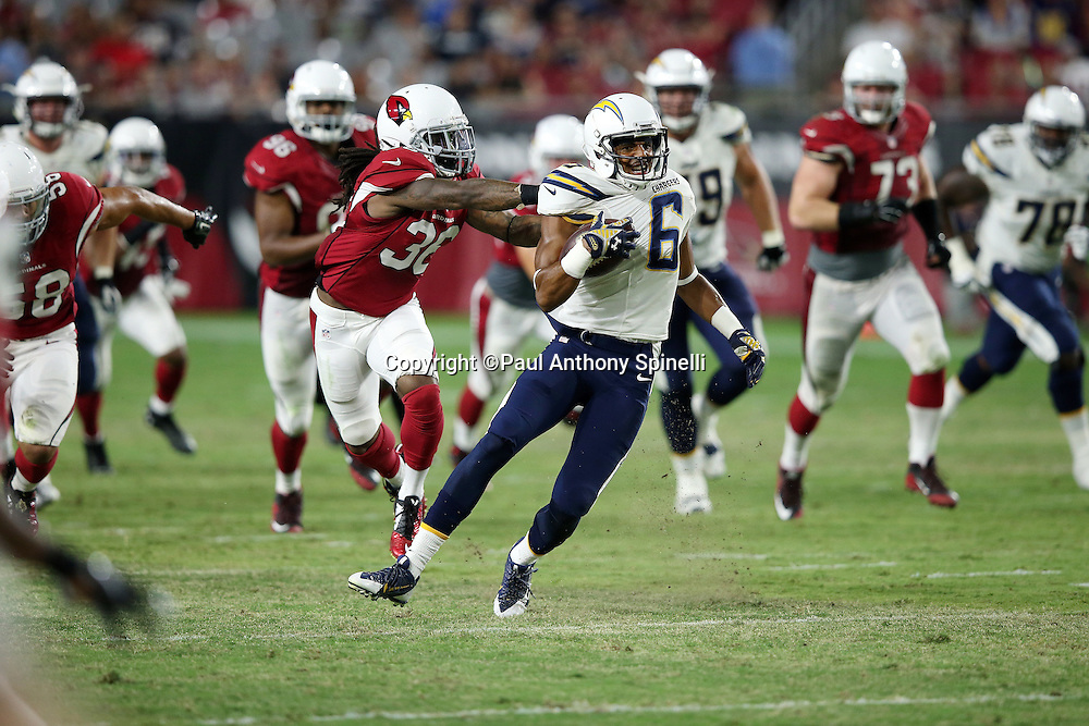 San Diego Chargers wide receiver Tyrell Williams (6) gets tackled by Arizona Cardinals defensive back C.J. Roberts (36) after catching a first down pass during the 2015 NFL preseason football game against the Arizona Cardinals on Saturday, Aug. 22, 2015 in Glendale, Ariz. The Chargers won the game 22-19. (©Paul Anthony Spinelli)