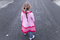 Back view of young child; alone,