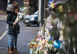 © Licensed to London News Pictures. 28/01/2018. London, UK. Flowers being placed at the scene where three teenage pedestrians were killed near a bus stop in Hayes, West London when a black Audi collided with them. Named locally as Harry Rice, Josh Kennedy and George Wilkinson, the three teenagers were hit on Friday night  close to the M4 Junction 4. A 28-year-old man has been arrested and a police are currently looking for a  second man believed to have been in the Audi.. Photo credit: Ben Cawthra/LNP