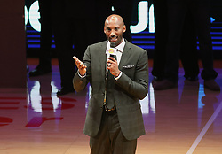 December 18, 2017 - Los Angeles, California, U.S - Former Los Angeles Laker Kobe Bryant addresses the fans  at a halftime ceremony, retiring both of his jersey s during a  NBA basketball game between the Los Angeles Lakers and  the Golden State Warriors, in Los Angeles, Monday,  December 18, 2017. (Credit Image: © Prensa Internacional via ZUMA Wire)